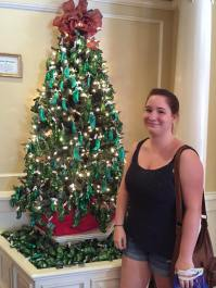 """Sarah posing with the """"pickle"""" tree in Epcot"""