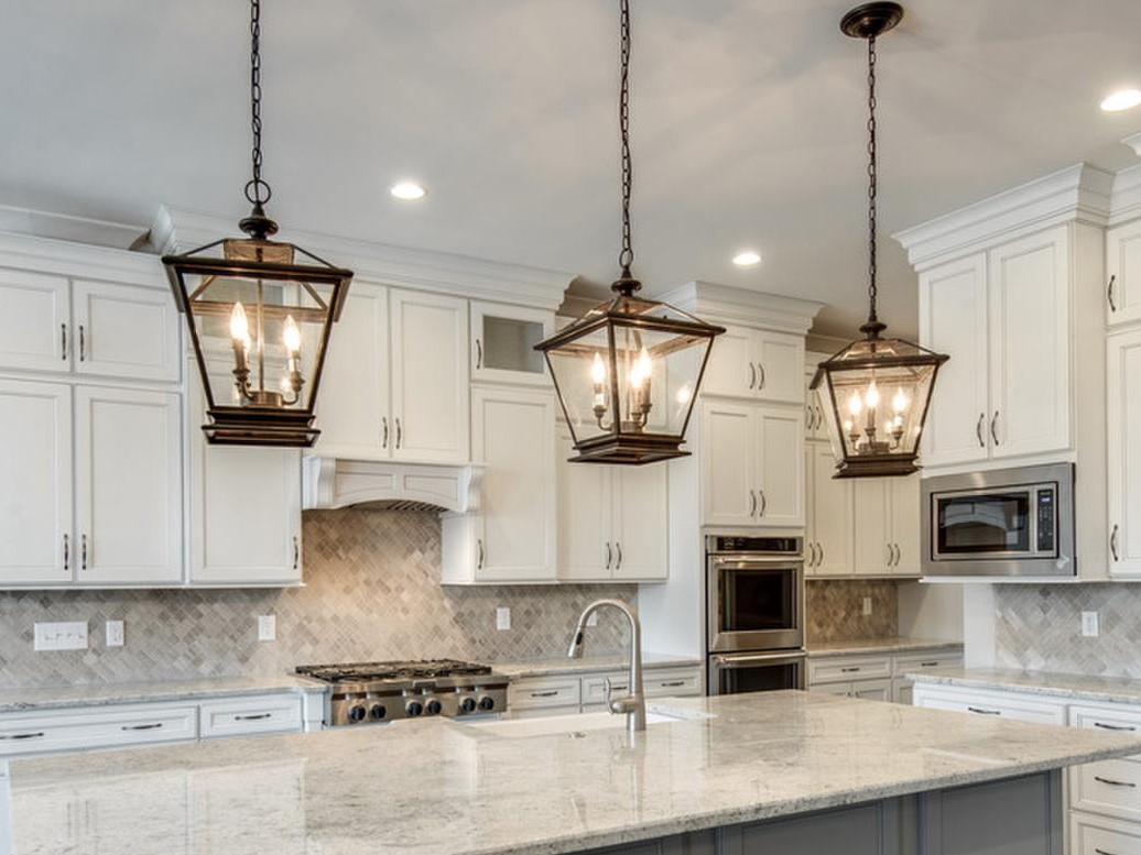 lighting over kitchen island sink with side drain board lantern style pendant lights