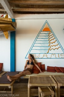 Woman relaxing at Swamis Cafe on Bingin Beach in Bali.
