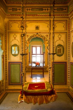 Hanging seat swing in a attached interior room of the City Palace in Udaipur.