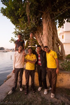Indian men posing for a picture in their front yard below the Palace.