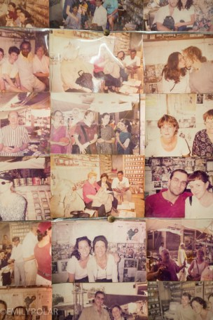 Old photos of past guests and clients in a spice shop of Jodhpur, India.