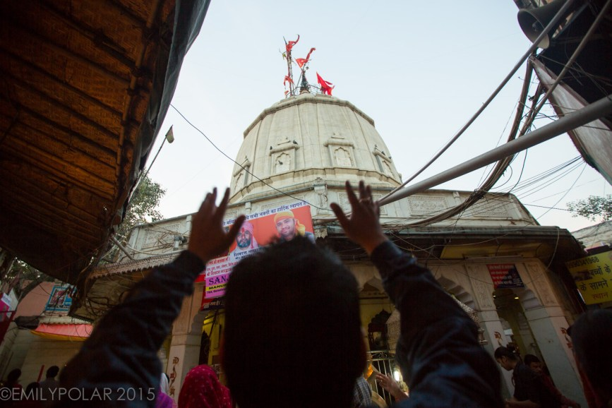 Man praying with hands up to Kali at Kalka Mandir Temple in South Delhi.