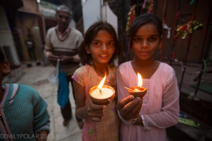 Indian girls playing with candles at Kali Temple in South Delhi Kalka Mandir Temple.