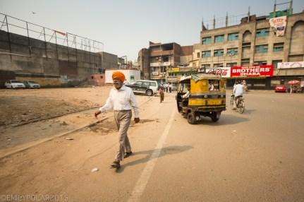 Stylish Punjabi man walking down the street in Amritsar.