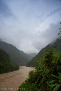 The Seti Gandaki river flowing through the green lush valley of Nepal.