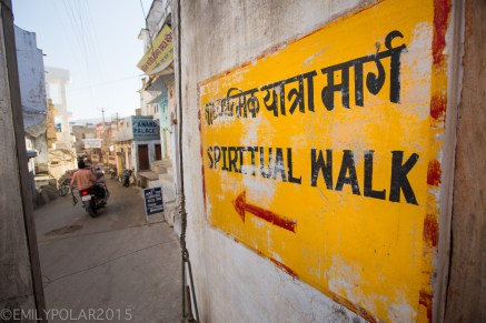 Spiritual walk sign painted on home along the road that circles Pushkar Lake in Rajasthan, India.