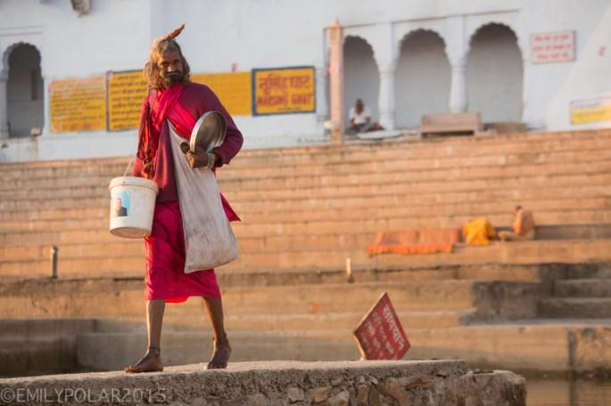 Mentally unstable Indian man walking along pathway above Pushkar Lake in Rajasthan.