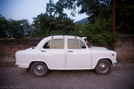 Classic antique white taxi parked on the streets of Rishikesh in India.