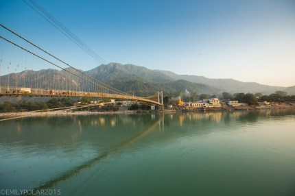 Ram Jhula bridge over the holy blue Ganges river in Rishikesh, India.