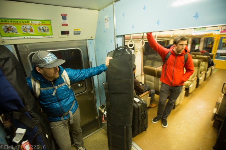 Snowboarders riding the train from Chitose airport to Sapporo en route to snowboarding in Niseko.
