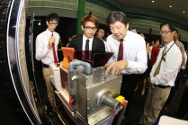 MIN taking a closer look at the Fish Slicing Machine by Eng Han Rong Rayner, Timothy Lee Ke Xin and Shawn Ng Zhi Sheng (Merit Award Winner from ITE College West) which saves the time spent to manually cut fishes.