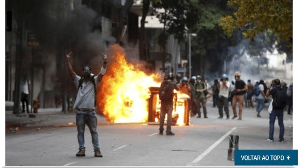 Isso é postura de manifestante ou terrorista? Foto de O Globo