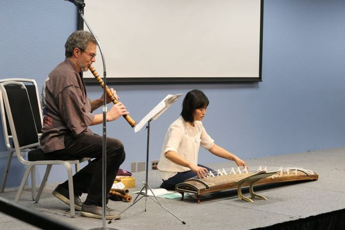 Paul Amiel (shakuhachi) and Akiwa Abe Brown (koto) performing a duet