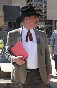 "Rep. Mark Finchem likes to dress up in cowboy hats, rawhide jackets, and Colonel Sanders ties. He's from Michigan and imagines it's a very ""Western"" look."