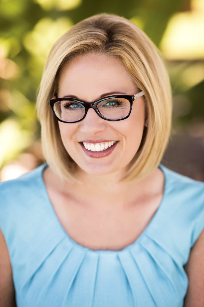 Kyrsten Sinema Vows to...