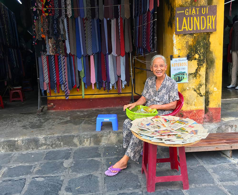 Lady selling cards in Hoi An Vietnam