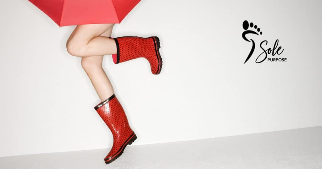 Sole Purpose in red gumboots