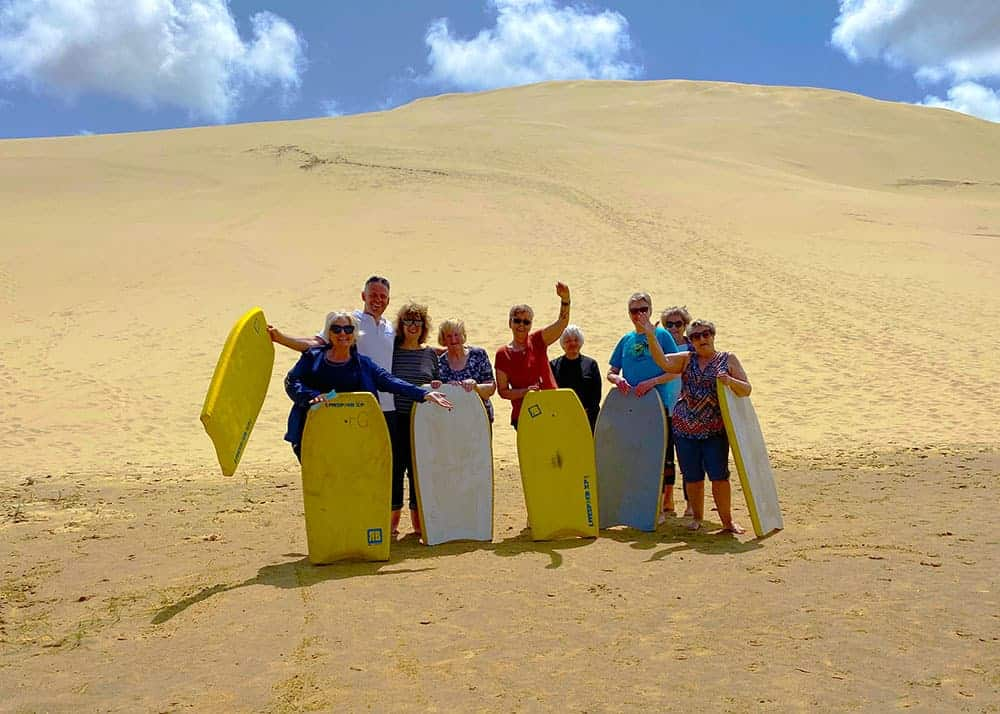 Boogie boarding down Ninety Mile Beach sand dunes