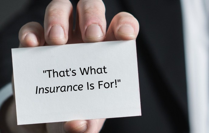"mans hand holding business card, with text across, ""That's What Insurance Is For!""."