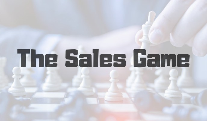"Man Playing Chess (facing camera, close up), with quote, ""The Sales Game"" across photo."