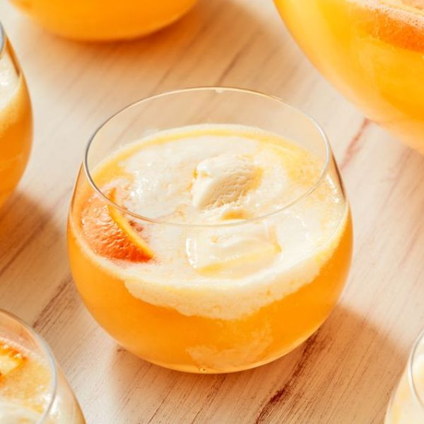 The Creamsickle Punch recipe requests two quarts of orange juice, two cups of vodka, a liter of ginger ale, one bottle of prosecco, a quart of vanilla ice cream, and an orange tnat is thinly sliced.