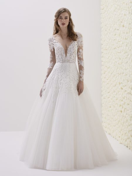 Lace is elegant, but even in a modern wedding dress, it suits.