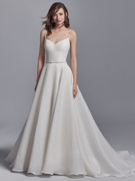 Perhaps one of the most simple modern wedding dresses out there- without sleeves, but not without style!