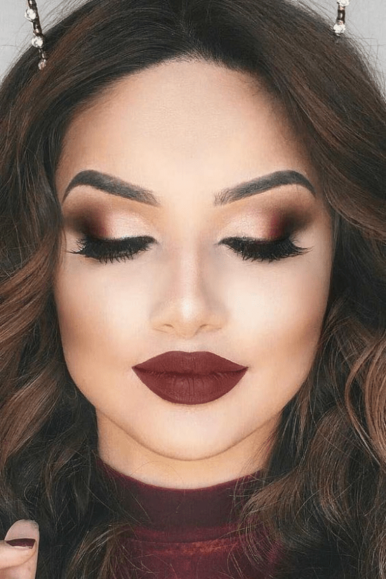 earthy red lip and bright eye makeup look