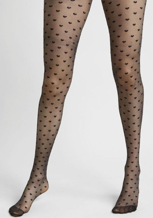 *Logo Tights Will Be Huge This Winter And We Are Obsessed