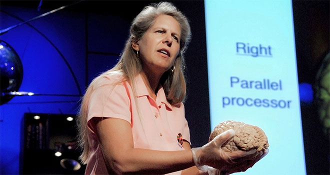 Woman holding a brain prop in a presentation