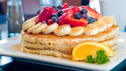 """Kekes Breakfast Cafe's popular """"Florida Waffle"""" which is topped with bananas, blueberries and strawberries"""