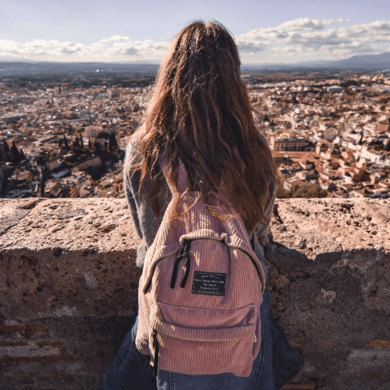 girl travelling and looking at view