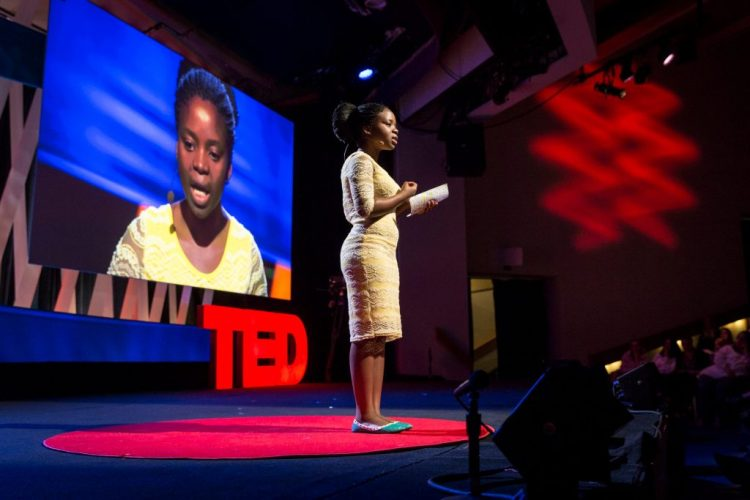 A woman speaking at a TED talk
