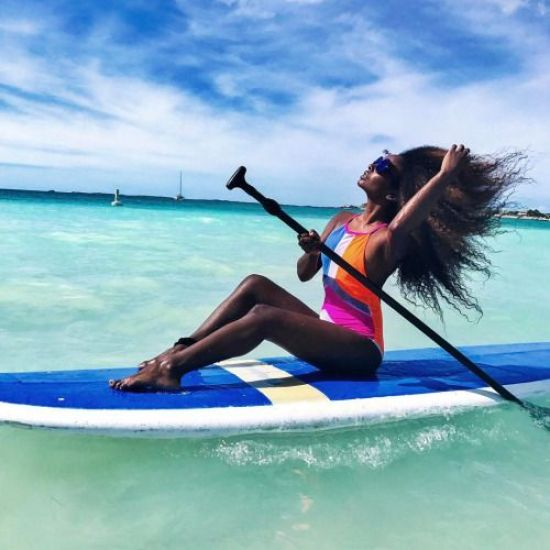 My Experience Surfing As A Black Girl Starts With A Board And Crazy Kinky Hair