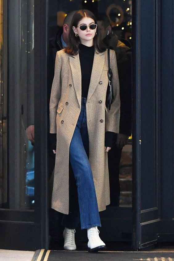 Kaia stepping out in a light brown trench coat.
