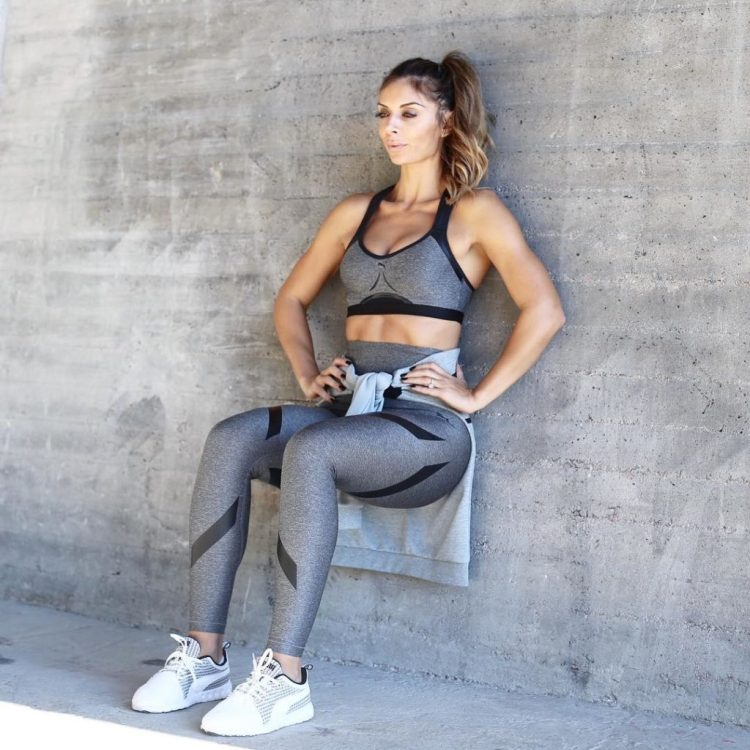 Woman Doing Wall Sits