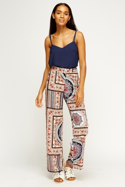 5 Ways To Wear A Studded Belt Outside Of A Festival With Patterned Trousers