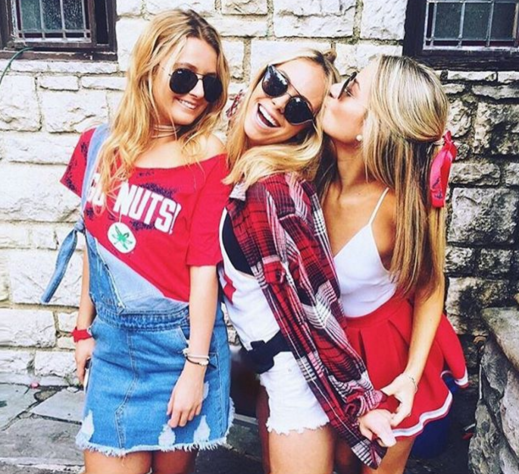 Overalls and bows are the perfect accessories for gameday outfits at Ohio State University!