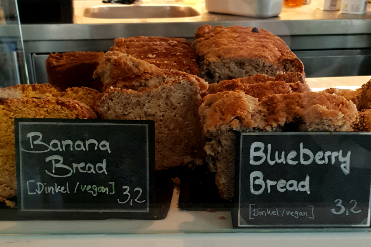 Vegan pumpkin, banana and blueberry breads in counter display at Wagner's, Munich
