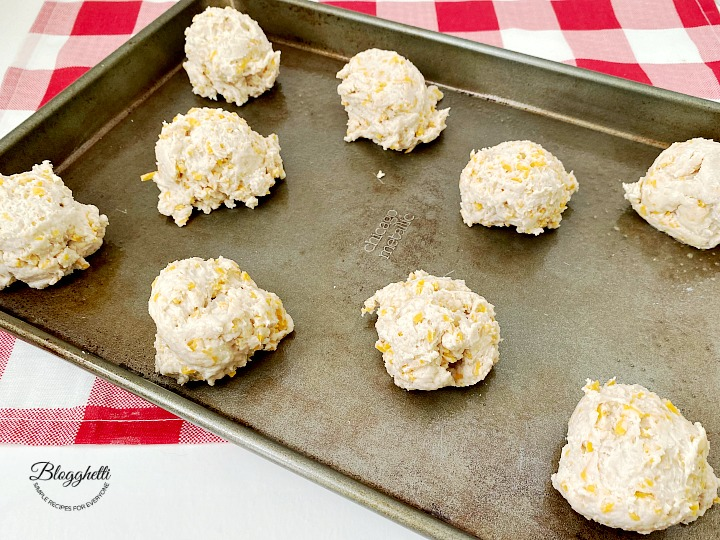 cheese biscuit dough on baking sheet