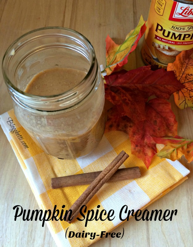 Pumpkin spice creamer in mason jar with can of pumpkin in picture