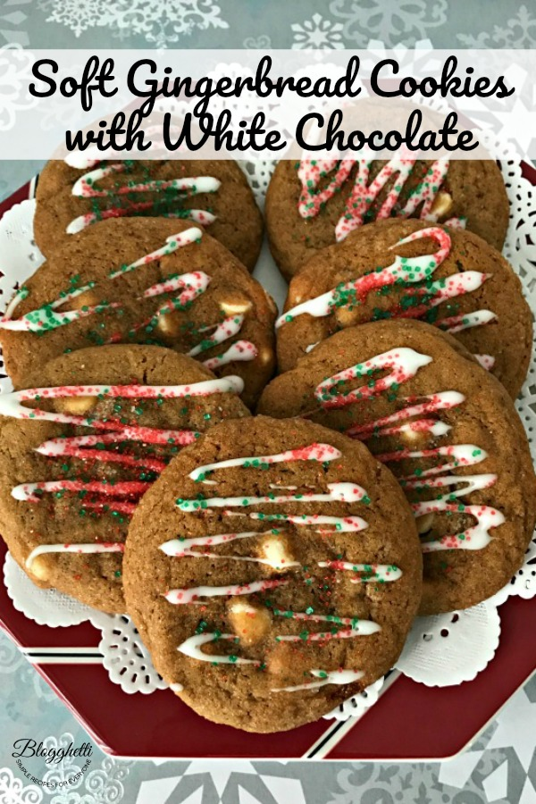 Soft gingerbread cookies with white chocolate chips on plate