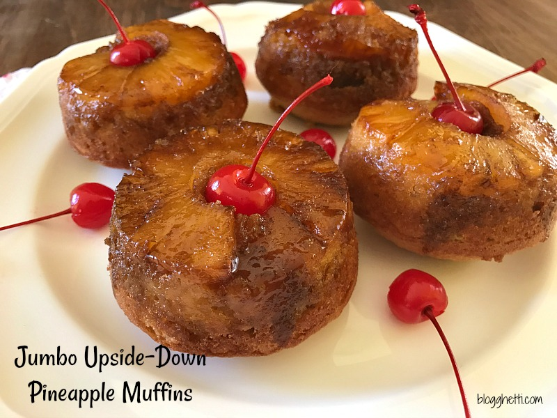 These Jumbo Upside-Down Pineapple Muffins are sweet and simple to make from scratch. Topped with a brown sugar glaze, pineapple ring, and a maraschino cherry they make the perfect sweet treat.