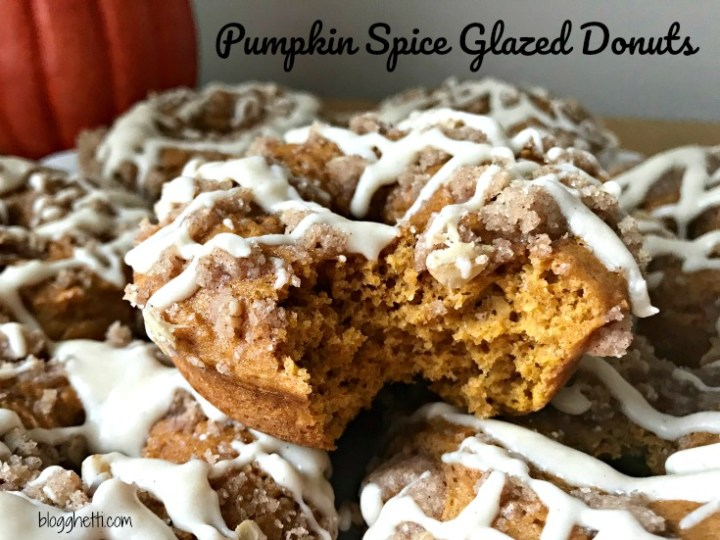 Pumpkin Spice Glazed Donuts from a simple boxed cake mix will make your family think you made them from scratch. The donuts are topped with a streusel and then drizzled with a maple glaze.