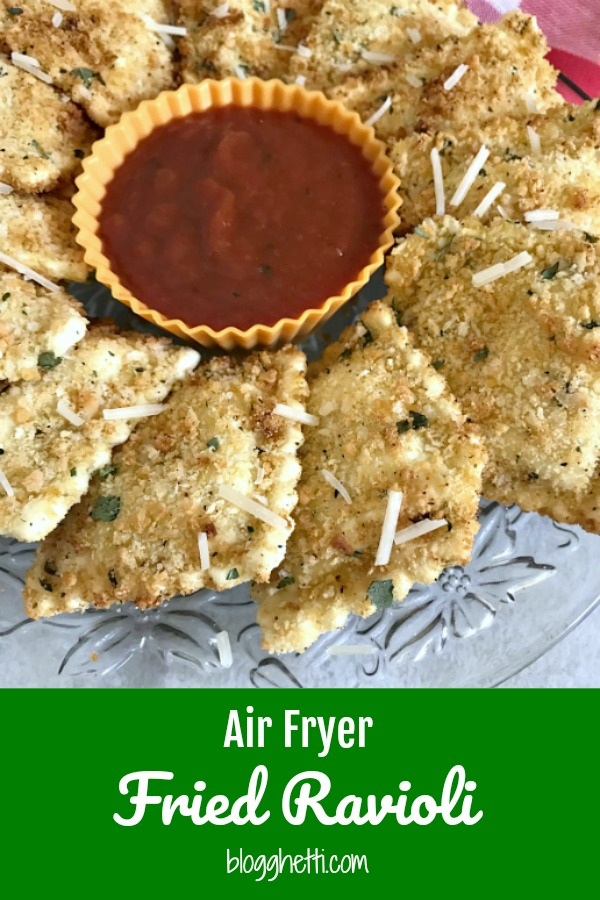 Air Fryer Fried Ravioli on a crystal plate with marinara dipping sauce.