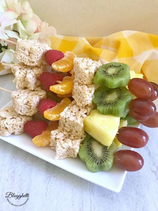 Spring Fruit and Rice Krispies Treat Kabobs on plate