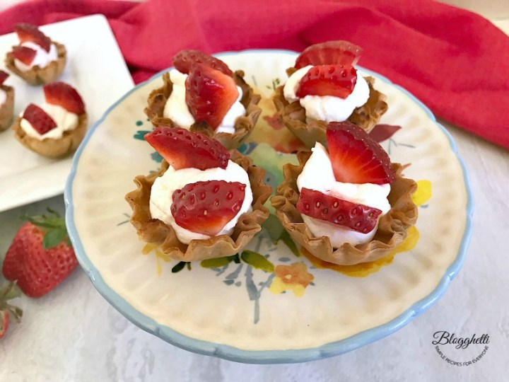 No Bake Mini Strawberry Cheesecake Cups on platter- feature