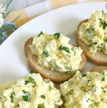 Deviled Egg Crostini on white plate