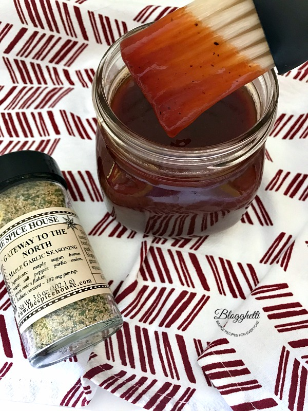 Cherry Bourbon BBQ Sause in jar with basting brush